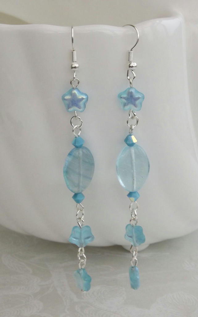 Comet, pale blue ovals and sparkling star dangle earrings