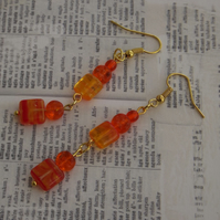 Orange glass dangle earrings, beautiful bright and shiny