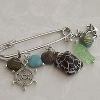 Tortuga, nautical themed silver tone charms, scallop shells and turtle brooch