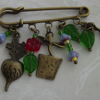 Allotment, kilt pin brooch with charms and beads