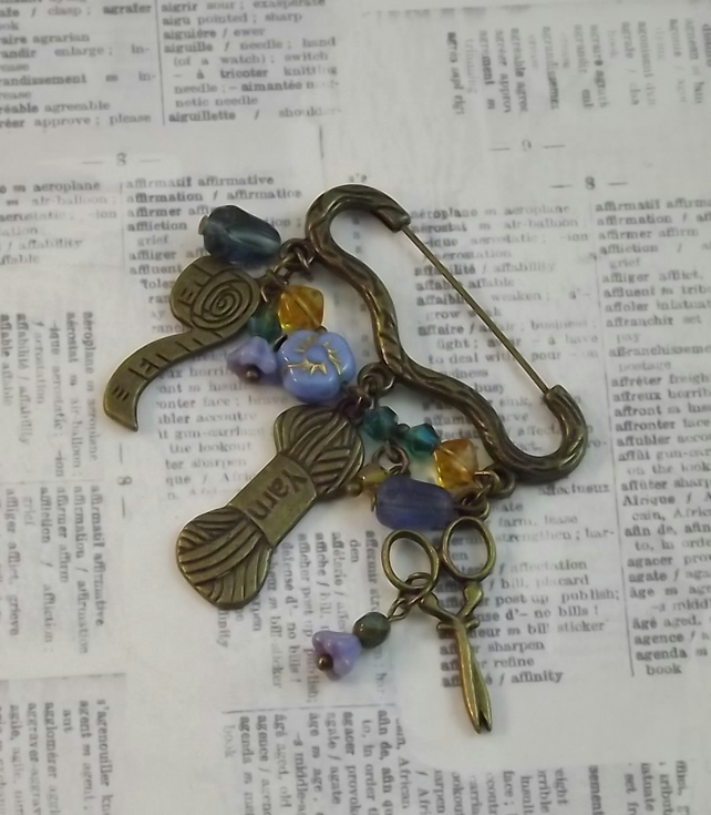Antique style Kilt Pin with sewing charms and glass flower beads. Vintage,