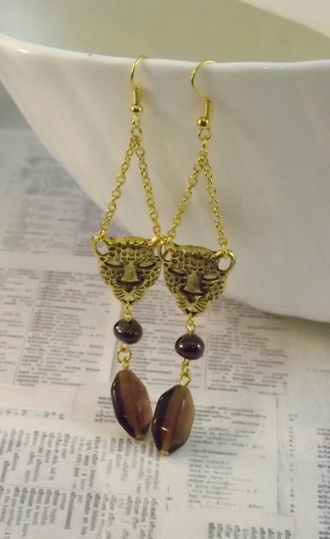 Leopard Head Gold coloured earrings with bronze and topaz glass beads.