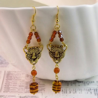 Leopard Mask and amber glass beads, dangle earrings.