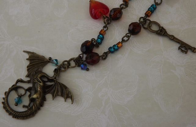 Dragon Heart, bronze metal winged dragon pendant, on beaded chain