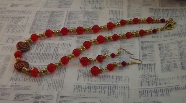 Ruby and Pearl, gold faux pearls with Ruby glass, heart detail