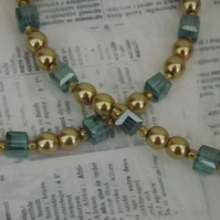 Grace, gold pearls and teal crystal cubes, necklace and earring set