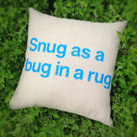 Snug as a bug appliqué cushion