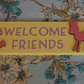 Handmade 'Welcome Friends' Deer sign plaque. Yellow, pink, butterflies, kitsch.