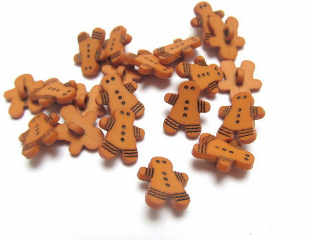 Gingerbread men buttons: pack of 20 plastic shank backed buttons.