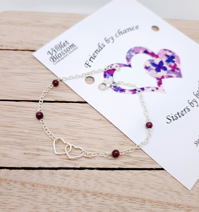 Sterling silver double heart bracelet with garnet