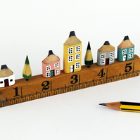 Miniature Pencil Houses. Wooden Street on Vintage Ruler