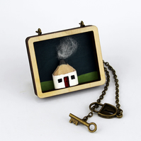 Necklace. Wooden Pencil Cottage in Laser Cut Plywood Frame. Painted Background