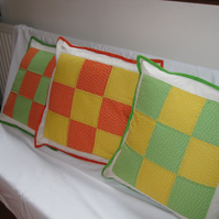 Citrus colours,  yellow and orange with small white spots cushion cover.