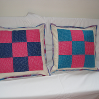 Pink and blue spotty cushion covers.