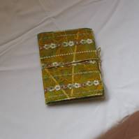 Medium green and yellow notebook cover.