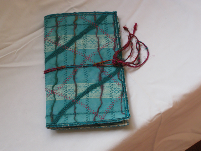 Large turquoise notebook cover.