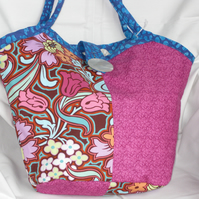Reversible bucket shaped bag in bright summery colours.