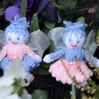 A pair of mini fairies , in pinks and lilac