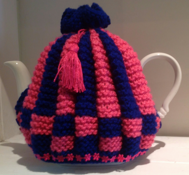 Knitted tea cosy in pink and blue