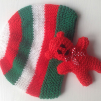 Knitted baby hat in Red, green, white  with little ted