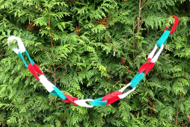 Knitted Christmas  chain in red, white and green