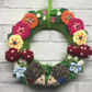 Nursery wreath, knitted woodland scene