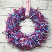 Knitted Christmas wreath, pink blue ribbon secret Santa