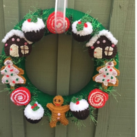 Knitted Christmas wreath, gingerbread men Christmas pudding,