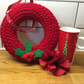 Knitted Christmas wreath with felt holly, door hanging