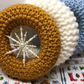 Knitted Christmas wreath with snowflake  door hanging
