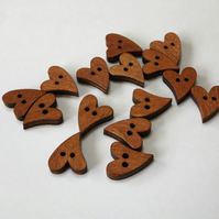 Wooden heart buttons, each one 20mm x 15mm with a slightly quirky shape