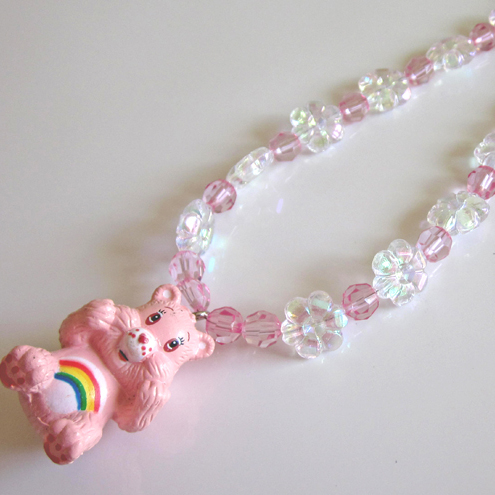 Child's sparkly pink Care Bear necklace