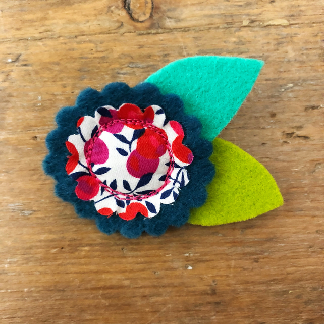 Felt and fabric flower brooch in teal and green with Liberty Fabric centre