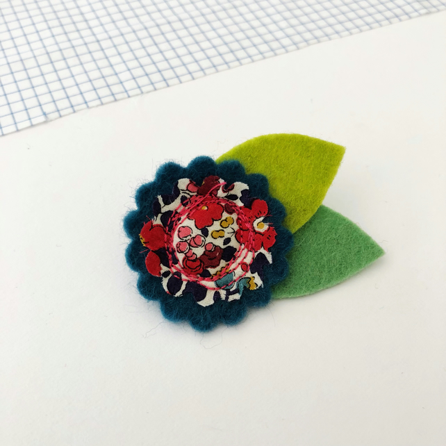 Teal blue felt flower brooch with Liberty fabric centre