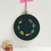 Stitched leaf wreath hoop art in bright jewel colours, perfect winter wall art