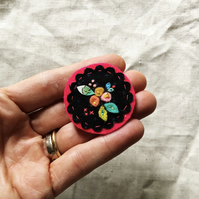 Navy and pink fabric collage brooch with embroidery detail