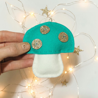 Turquoise blue handstitched felt toadstool with gold glitter spots