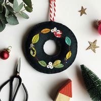 Appliquéd felt leaf wreath in bright jewel colours