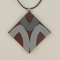7- DIAMOND SHAPED LEATHER PENDANT
