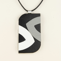23 - OBLONG LEATHER PENDANT