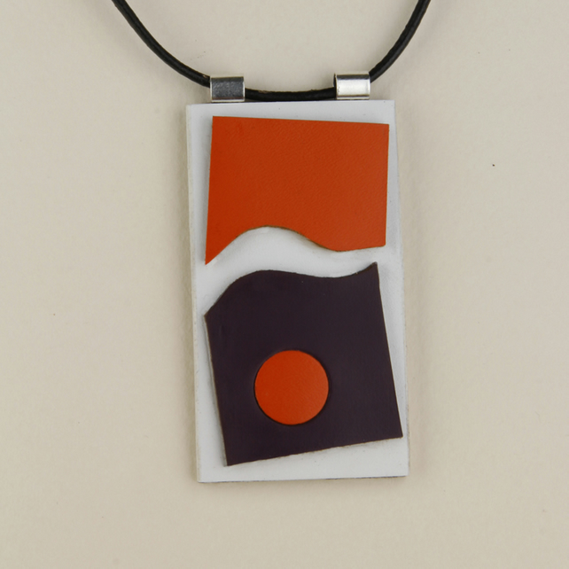 27 - OBLONG LEATHER PENDANT