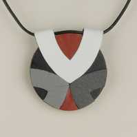 31 - ROUND LEATHER PENDANT