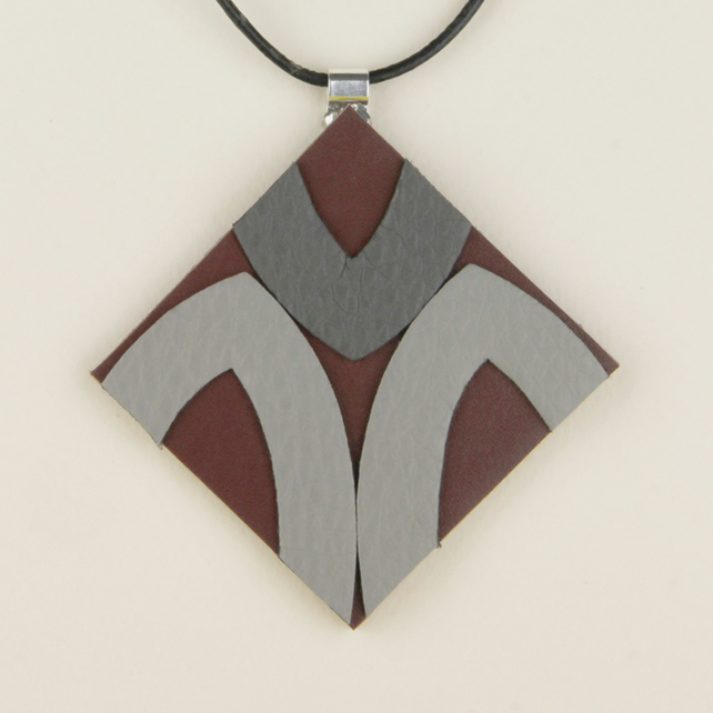 9 - DIAMOND SHAPED LEATHER PENDANT
