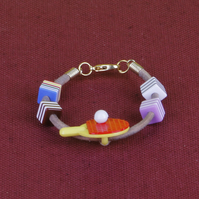 6 - CHILD'S LEATHER THONG BRACELET