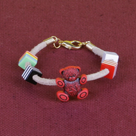 7 - CHILD'S LEATHER THONG BRACELET