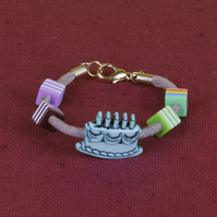8 - CHILD'S LEATHER THONG BRACELET