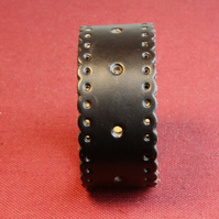 27 - BLACK SHAPED AND PIERCED LEATHER BRACELET