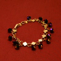 48 - GOLD METAL BRACELET WITH FACETED BEADS
