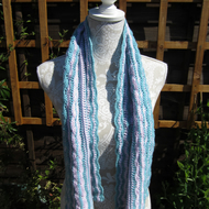 A crocheted Ripple Scarf or Wrap made with Baby Merino Yarn