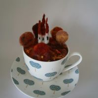 Fairy Tale Castle in the Woods. Felted landscape in a tea cup.